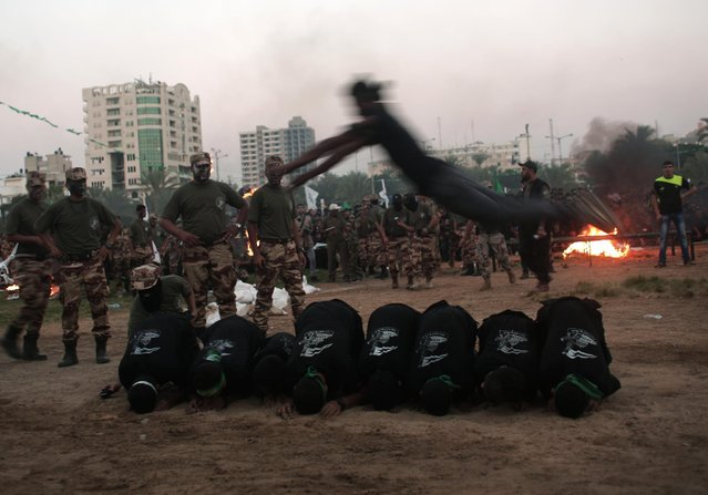 Young Palestinians display their military skills during a graduation ceremony of the Hamas, Liberation Youth, military summer camp, in Gaza City, Wednesday, August 5, 2015. (Photo by Khalil HamraAP Photo)