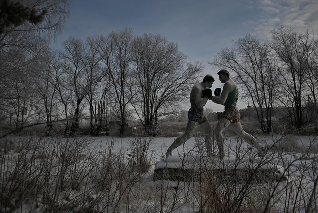 A sculpture of boxers is seen at an abandoned pioneer camp in the village of Chernoluchye in Omsk region, Russia on December 11, 2019. (Photo by Alexey Malgavko/Reuters)