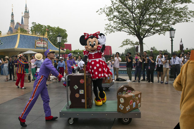 "A Disney character takes part in a parade on the eve of the opening of the Disney Resorts in Shanghai, China, Wednesday, June 15, 2016. The debut of Shanghai Disneyland offers Walt Disney Co. ""incredible potential"" for boosting its brand in the world's most populous market, Disney's chief executive said Wednesday ahead of Thursday's grand opening for the $5.5 billion park. (Photo by Ng Han Guan/AP Photo)"