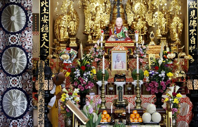 A Buddhist monk prays for victims of the 1945 atomic bombing at Nipponzan Myohjii temple in Nagasaki, western Japan, August 8, 2015, on the eve of the 70th anniversary of the bombing of Nagasaki. Japan will mark on Sunday the 70th anniversary of the attack on Nagasaki, where the U.S. dropped a second atomic bomb on August 9, 1945, which killed about 40,000 instantly. (Photo by Toru Hanai/Reuters)
