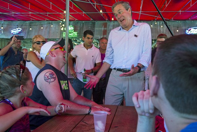 U.S. Republican presidential candidate Jeb Bush (2nd R) shares a laugh with attendees at the Iowa State Fair in Des Moines, Iowa, United States, August 14, 2015. (Photo by Jim Young/Reuters)