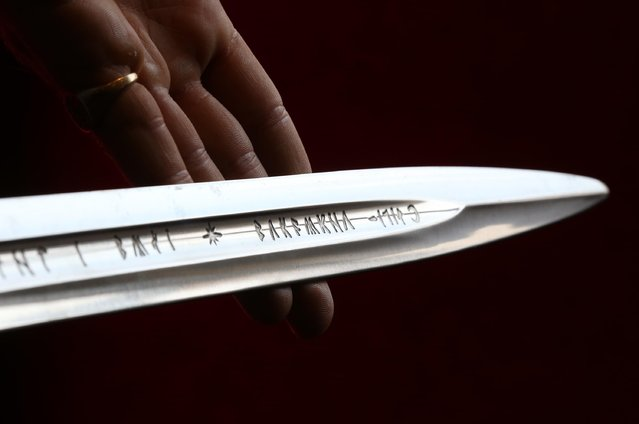 """Elvish writing is seen on """"Anduril"""", a prop sword belonging to Aragorn, hero of """"The Lord of the Rings"""" movie trilogy on July 31, 2014 in London, England. The sword, belonging to actor Sir Christopher Lee and estimated at $150,000-250,000, forms part of Bonhams """"There's No Place Like Hollywood"""" movie memorabilia auction taking place in New York on November 24, 2014. (Photo by Peter Macdiarmid/Getty Images)"""
