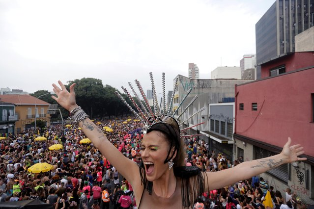 "A reveller reacts while taking part in the ""Academicos do Baixo Augusta"" block party in Sao Paulo, February 16, 2020. (Photo by Rahel Patrasso/Reuters)"