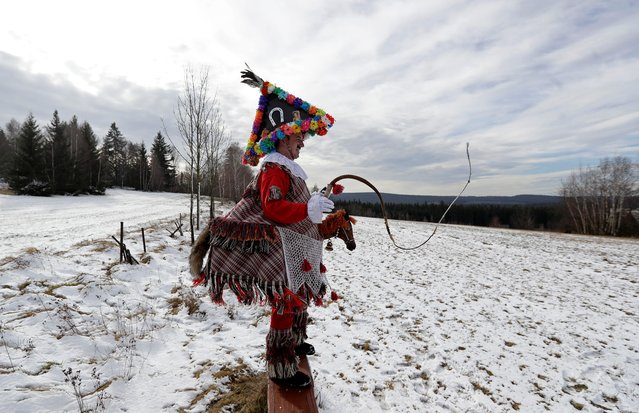 A reveller cracks his whip during a traditional carnival celebrating the departing winter and forthcoming spring in the village of Vortova near the east Bohemian city of Hlinsko, Czech Republic, February 22, 2020. (Photo by David W. Cerny/Reuters)
