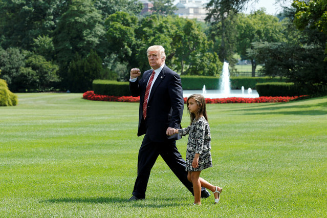 U.S. President Donald Trump gestures as he walks with his granddaughter Arabella on the South Lawn of the White House in Washington, U.S., before his departure to Camp David, August 25, 2017. (Photo by Yuri Gripas/Reuters)