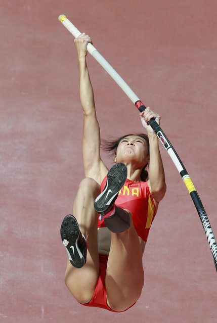 Ling Li of China competes in the women's pole vault qualification during the 15th IAAF World Championships at the National Stadium in Beijing, China August 24, 2015. (Photo by Kim Kyung-Hoon/Reuters)