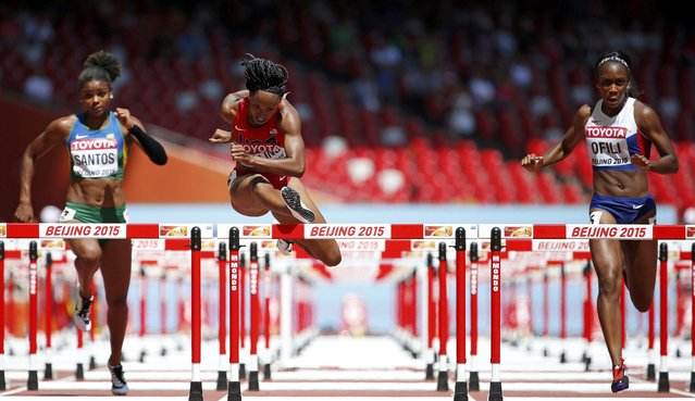 Brianna Rollins of the U.S. (C) and Cindy Ofili of Britain compete in the women's 100 metres hurdles heats during the 15th IAAF World Championships at the National Stadium in Beijing, China August 27, 2015. (Photo by Lucy Nicholson/Reuters)