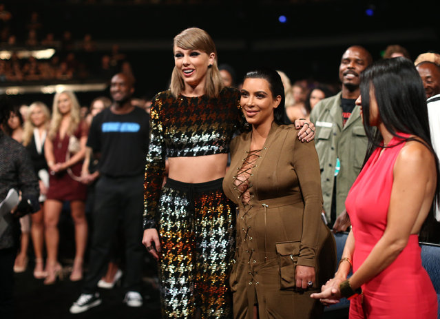 Recording artist Taylor Swift (L) and TV personality Kim Kardashian attend the 2015 MTV Video Music Awards at Microsoft Theater on August 30, 2015 in Los Angeles, California. (Photo by Christopher Polk/MTV1415/Getty Images)