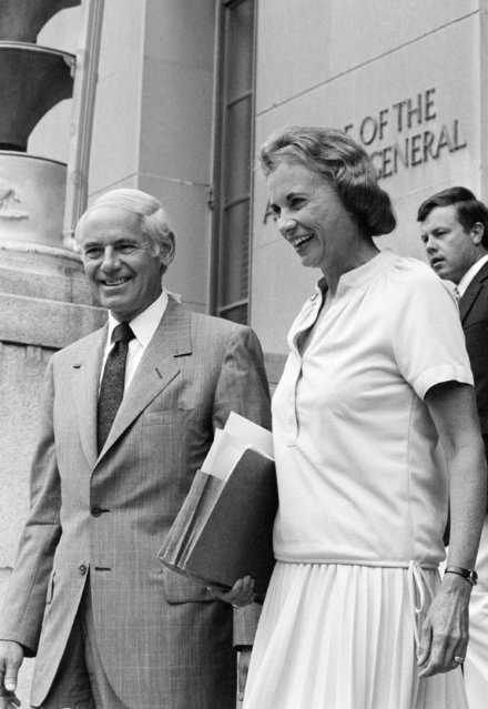 Supreme Court nominee Sandra Day O'Connor, right, is escorted by Attorney General William French Smith towards a waiting car as she departs the Department of Justice in Washington on September 4, 1981. O'Connor's confirmation hearings open next week on Capitol Hill. (Photo by Dennis Cook/AP Photo)