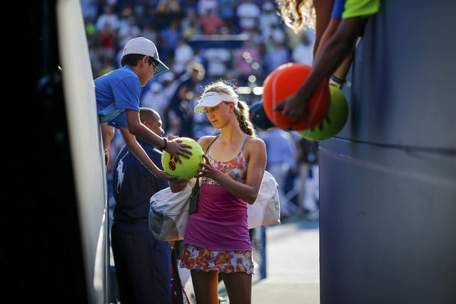 Mona Barthel of Germany signs autographs for fans after being defeated by Varvara Lepchenko of the U.S. in their third round match at the U.S. Open Championships tennis tournament in New York, September 5, 2015. (Photo by Eduardo Munoz/Reuters)