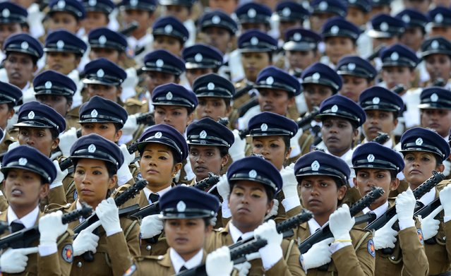 Sri Lankan policewomen march during a Victory Day parade in the southern town of Matara on May 18, 2014. (Photo by Lakruwan Wanniarachchi/AFP Photo)