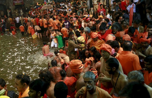 "Devotees take a dip in a holy pond during the second ""Shahi Snan"" (grand bath) at ""Kumbh Mela"", or Pitcher Festival, in Trimbakeshwar, India, September 13, 2015. (Photo by Danish Siddiqui/Reuters)"
