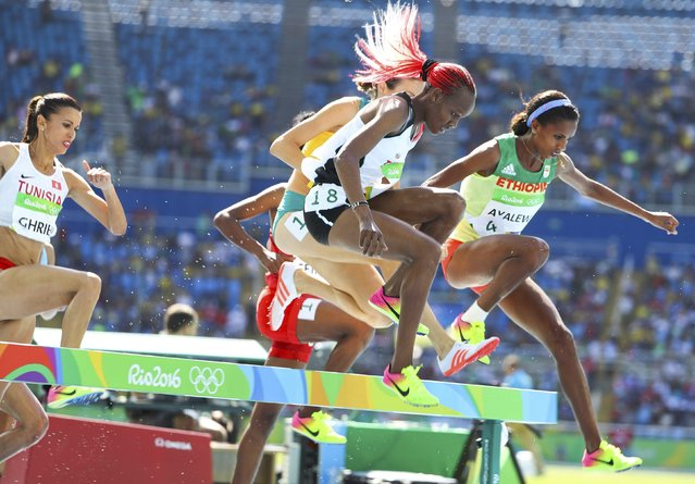 2016 Rio Olympics, Athletics, Preliminary, Women's 3000m Round 1, Olympic Stadium, Rio de Janeiro, Brazil on August 13, 2016. Meryem Akda (TUR) of Turkey and Hiwot Ayalew (ETH) of Ethiopia compete. (Photo by Lucy Nicholson/Reuters)