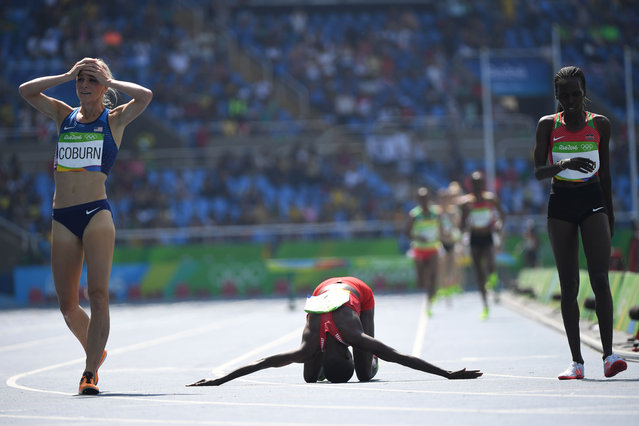 Bahrain's Ruth Jebet (C) celebrates after she won the Women's 3000m Steeplechase Final during the athletics event at the Rio 2016 Olympic Games at the Olympic Stadium in Rio de Janeiro on August 15, 2016. (Photo by Olivier Morin/AFP Photo)