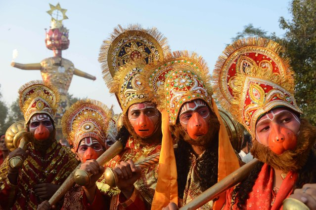 Indian Hindus dressed as deities Lord Hanuman pose during a religious procession on the grounds of Durgiana temple in Amritsar on October 24, 2012 on the occasion of the Hindu festival of Dussehra. Held at the end of the Navratri (nine nights) Festival, Dussehra symbolises the victory of good over evil in Hindu mythology. On the night of Dussehra, fire-crackers and stuffed effigies of Ravana are set alight in open grounds across the country. (Photo by Narinder Nanu/AFP Photo)