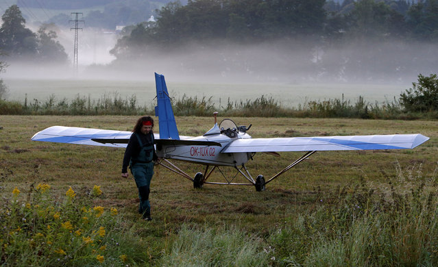 Aviator Frantisek Hadrava pulls Vampira, an ultralight plane based on the U.S.-design of light planes called Mini-Max, on a field near the town of Ckyne, Czech Republic, August 24, 2016. (Photo by David W. Cerny/Reuters)