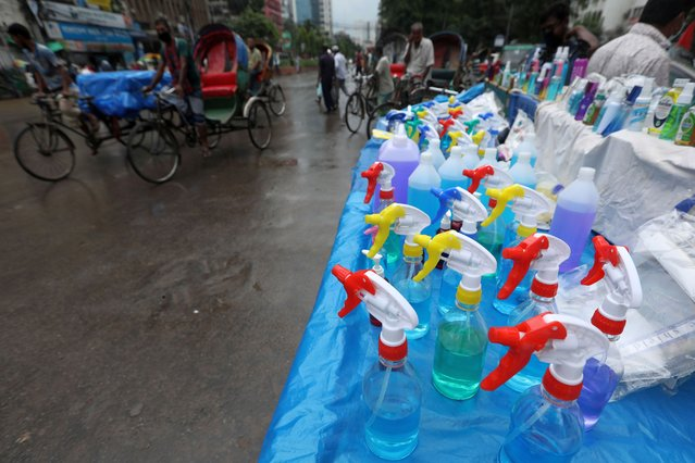 A display of fake hand sanitizer bottles in a market during the coronavirus crisis. Bangladesh has recorded 37 new deaths from the deadly Covid-19 in a 24-hour span on Thursday, taking the total number of fatalities to 1,049.The country also recorded 3,187 new Covid-19 cases over the same period, taking the total number of active cases in the country to 78,052. (Photo by Md Manik/SOPA Images/Rex Features/Shutterstock)