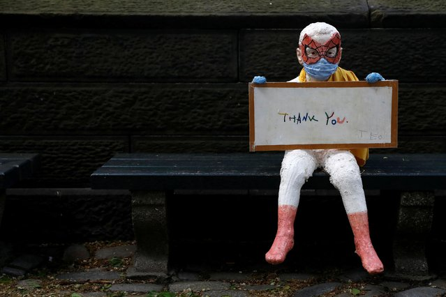 """An art piece titled """"-ThAnK YoU-"""" by Benat Iglesias Lopez and his four-year-old son Teo to thank frontline workers, sits on a bench outside Central Park during the outbreak of the coronavirus disease (COVID-19) in the Manhattan borough of New York City, U.S., May 9, 2020. (Photo by Andrew Kelly/Reuters)"""