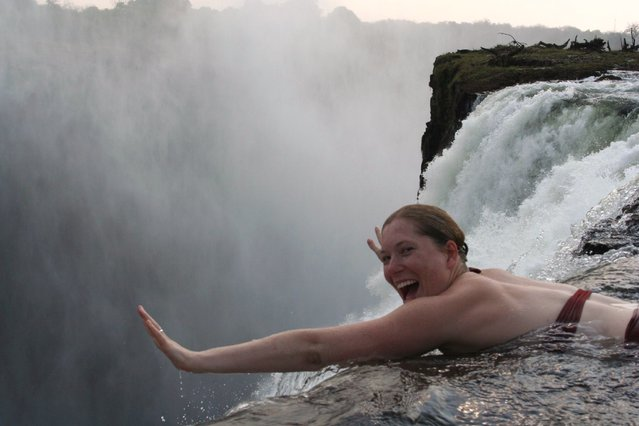 Angela would like to jump... don't leave me honey! Devil's Pool, Victoria Falls. (Photo by Fritz Stugren)