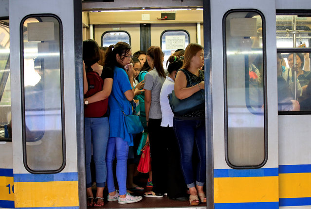 Commuters stand inside a jam-packed passenger coach of the Light Rail Transit System (LRT) at the central station in Metro Manila, Philippines June 21, 2016. (Photo by Romeo Ranoco/Reuters)