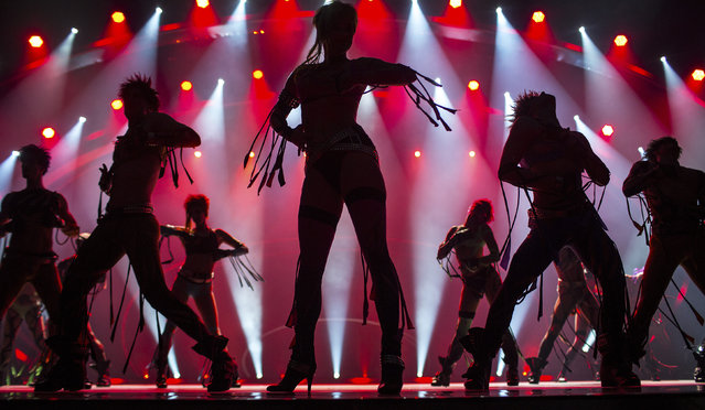 Dancers are silhouetted during a dress rehearsal. (Photo by Hannibal Hanschke/Reuters)