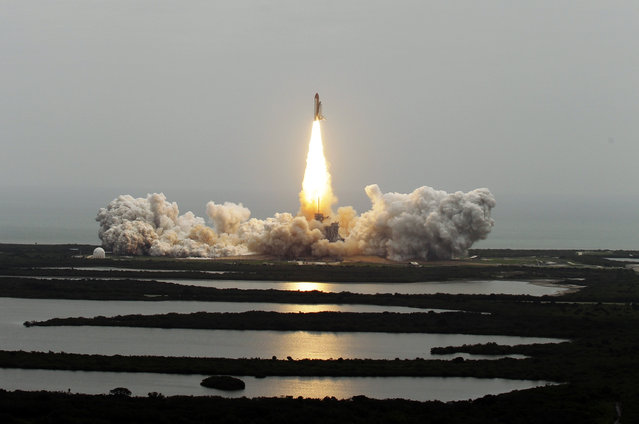 In this July 8, 2011 file photo, the space shuttle Atlantis lifts off from the Kennedy Space Center in Cape Canaveral, Fla. This is the 135th and final space shuttle launch for NASA. (Photo by Chris O'Meara/AP Photo)