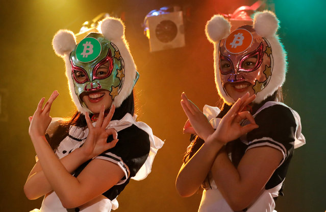 "Members of Japan's idol group ""Virtual Currency Girls"" wearing cryptocurrency-themed masks perform in their debut stage in Tokyo, Japan, January 12, 2018. Japan and South Korea are home to some of the bigger digital exchanges, with investors piling in as growth in bitcoin and other cryptocurrencies soared last year, provoking regulators' concerns. (Photo by Kim Kyung-Hoon/Reuters)"