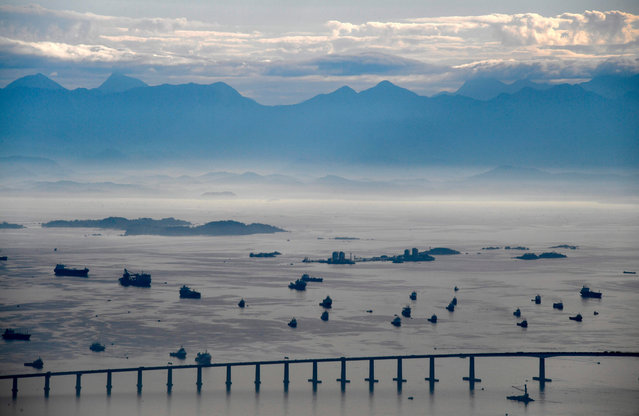 Aerial view of the Rio-Niteroi bridge over the Guanabara bay as seen from the Corcovado mountain in Rio de Janeiro, Brazil on August 13, 2020. (Photo by Mauro Pimentel/AFP Photo)