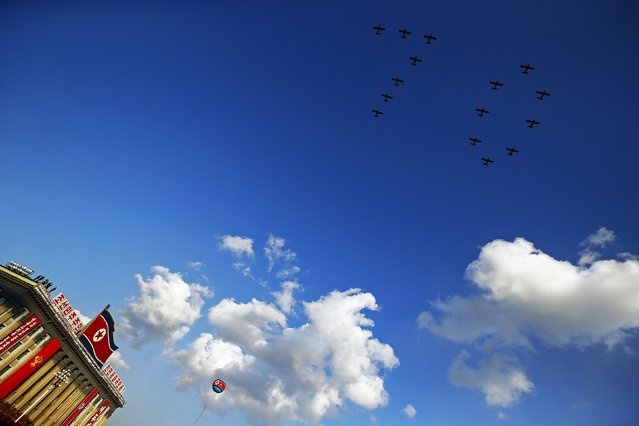 "Planes form the number ""70"" as they fly over Pyongyang's main Kim Il Sung Square during the parade celebrating the 70th anniversary of the founding of the ruling Workers' Party of Korea October 10, 2015. (Photo by Damir Sagolj/Reuters)"