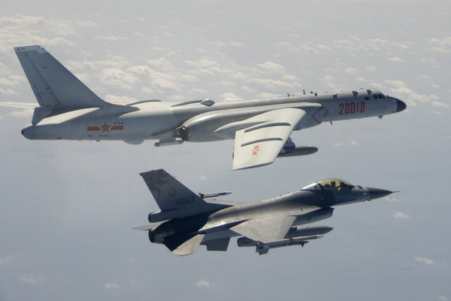 In this photo taken February 10, 2020, and released by the Republic of China (ROC) Ministry of National Defense, a Taiwanese Air Force F-16 in foreground flies on the flank of a Chinese People's Liberation Army Air Force (PLAAF) H-6 bomber as it passes near Taiwan. (Photo by Republic of China (ROC) Ministry of National Defense via AP Photo)