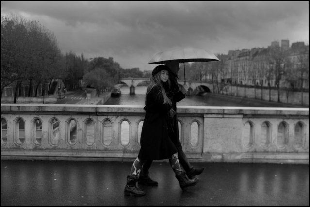 Love often feels simple, and beautiful, and that is how I feel about Paris always, and never more than on a rainy Sunday morning in early November, on my way for my first double expresso. (Photo and comment by Peter Turnley)