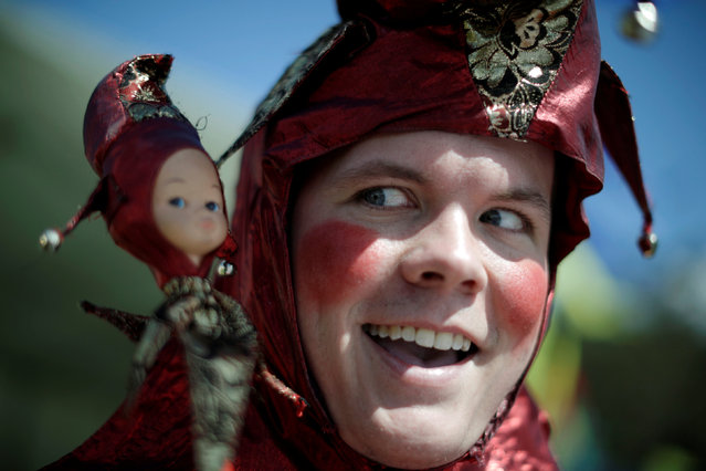 Jamie Oberg clowns for the camera as a court jester at the St Ives Medieval Fair in Sydney, one of the largest of its kind in Australia, September 24, 2016. (Photo by Jason Reed/Reuters)
