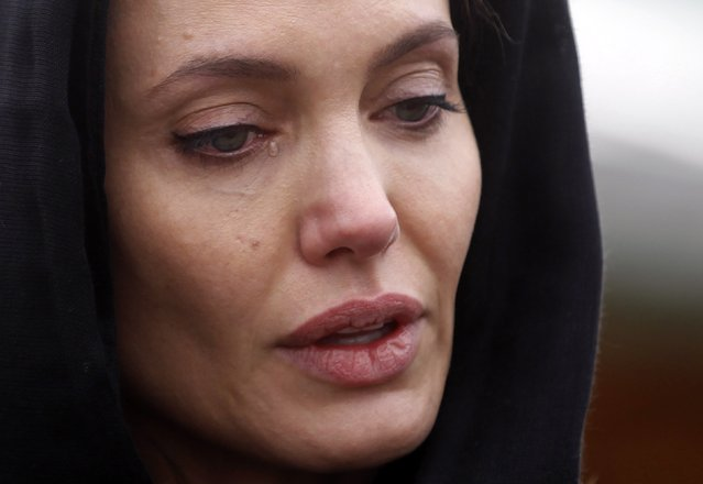 Actress Angelina Jolie cries at the Srebrenica Genocide Memorial in Potocari in this March 28, 2014 file photo. I was covering Angelina Jolie's visit to the Srebrenica Genocide Memorial and Cemetery, commemorating the brutal murder of 8,000 people in 1995, when she started to cry. Afterwards, she was due to visit rape victims' homes in the town of Zenica, so many photographers fled to the entrance to capture her departure. (Photo and caption by Dado Ruvic/Reuters)
