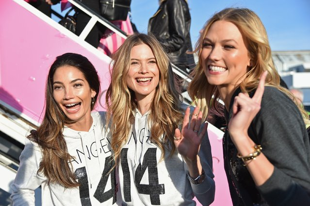 (L-R) Victoria's Secret Models Lily Aldridge, Behati Prinsloo and Karlie Kloss depart for London for the 2014 Victoria's Secret Fashion Show at JFK Airport on November 30, 2014 in New York City. (Photo by Mike Coppola/Getty Images for Victoria's Secret)