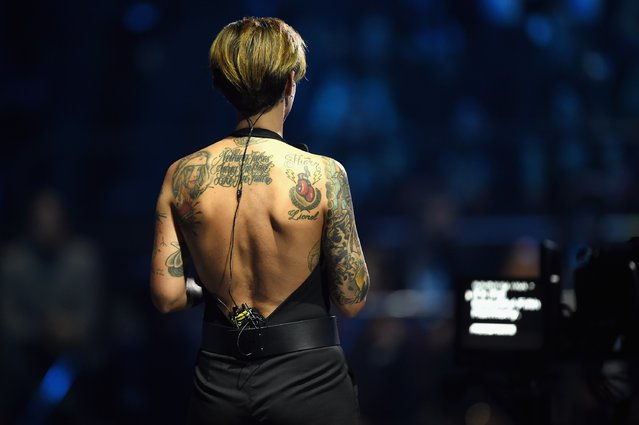 Co-host Ruby Rose back of tatoos is shown on stage during the MTV EMA's 2015 at the Mediolanum Forum on October 25, 2015 in Milan, Italy. (Photo by Brian Rasic/Getty Images for MTV)