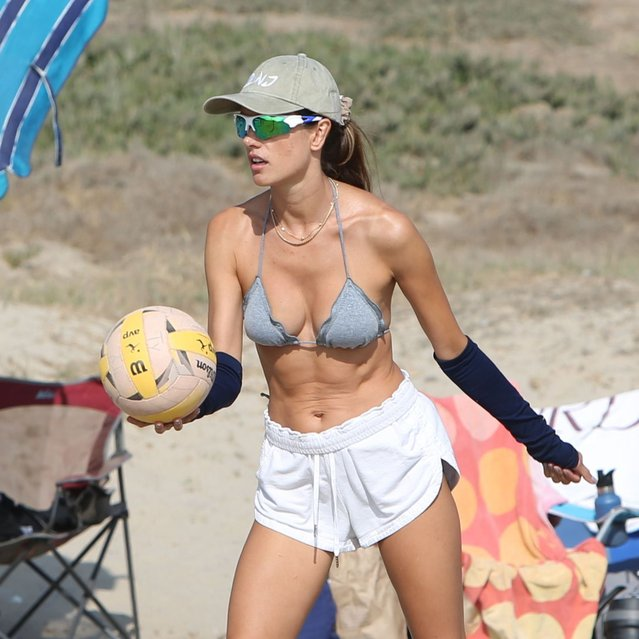 Brazilian model and television personality Alessandra Ambrosio shows off her ripped physique as the s*xy 39-year-old hits the beach with her pals on Saturday, October 10, 2020. The former Victoria's Secret Angel works tan while showcasing her volleyball skills during her weekly outing in Malibu. (Photo by X17/SIPA Press)
