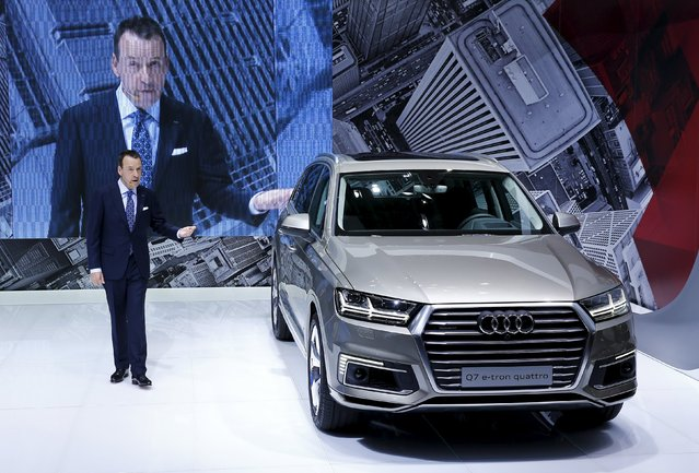 Andre Brown of Audi Japan presents the new Audi Q7 e-tron quattro at the 44th Tokyo Motor Show in Tokyo October 28, 2015. (Photo by Thomas Peter/Reuters)