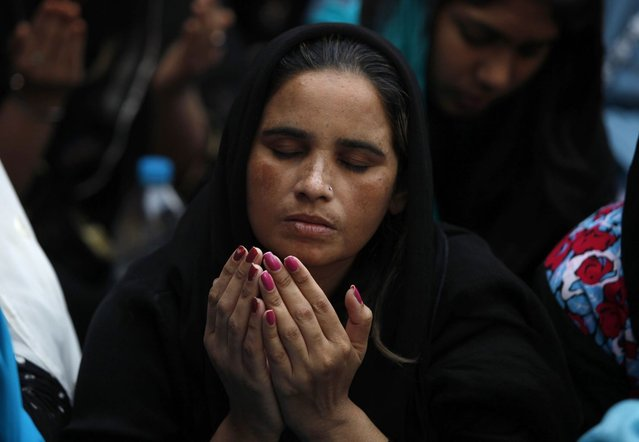 A Pakistani Christian woman prays during a Good Friday service at Saint Anthony Church in Lahore March 29, 2013. Holy Week is celebrated in many Christian traditions during the week before Easter. (Photo by Mohsin Raza/Reuters)