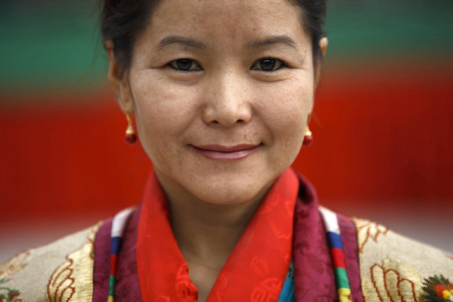 A Tibetan woman in traditional attire takes part during a function organised by the Tibetan Refugee Community in Nepal,  commemorating the 25th Anniversary of the Nobel Peace Prize conferment to exiled Tibetan spiritual leader Dalai Lama and the 66th International Human Rights Day in Kathmandu December 10, 2014. (Photo by Navesh Chitrakar/Reuters)