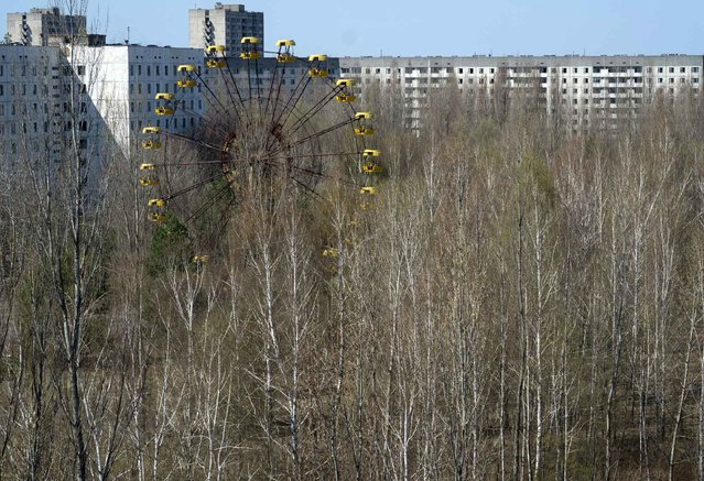 A view of the abandoned city of Pripyat is seen near the Chernobyl nuclear power plant April 23, 2013. (Photo by Gleb Garanich/Reuters)