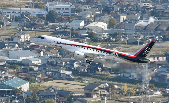 An aerial view shows Mitsubishi Aircraft Corp's Mitsubishi Regional Jet (MRJ) taking off for a test flight at Nagoya Airfield in Toyoyama town, Aichi Prefecture, central Japan, in this photo released by Kyodo November 11, 2015. Japan's first commercial jet in half a century made its maiden flight on Wednesday, in a breakthrough for the country's long-held ambition to establish an aircraft industry that can compete with some of the major players in global aviation. (Photo by Reuters/Kyodo News)