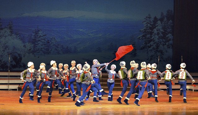 "Schoolchildren's New Year performance ""We Are the Happiest in the World"" is given at the Central Youth Hall on the occasion of the New Year, December 31, in this photo released by North Korea's Korean Central News Agency (KCNA) in Pyongyang December 31, 2014. (Photo by Reuters/KCNA)"