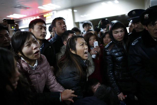 Relatives try to seek information at a hospital where those injured in a stampede are being treated in Shanghai, China, Thursday January 1, 2015. (Photo by AP Photo)