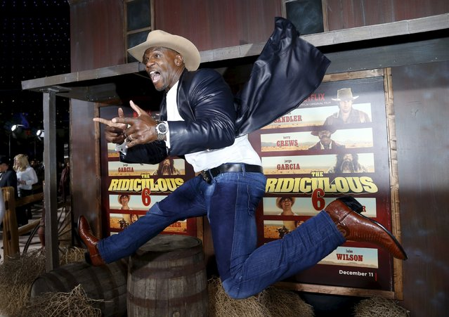 """Cast member Terry Crews jumps during the premiere of """"The Ridiculous 6"""" in Universal City, California, November 30, 2015. The movie opens in the U.S. on December 11. (Photo by Mario Anzuoni/Reuters)"""
