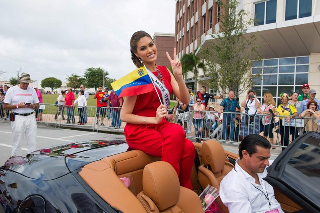Miss Universe 2013 Gabriela Isler of Venezuela takes part in a cultural parade and festival in Miami in this January 11, 2015 picture provided by the Miss Universe Organization. (Photo by Reuters/Miss Universe Organization)