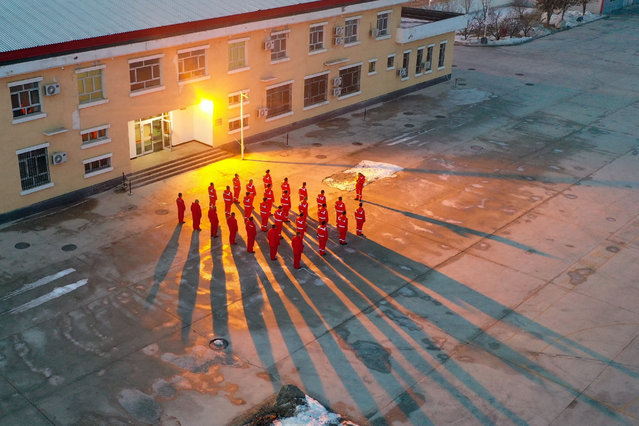 Maintenance workers go through attendance check before their shift at the Horgos initial compressor station of the West Pipeline Company under China Oil & Gas Pipeline Network Corporation (PipeChina) in Horgos, northwest China's Xinjiang Uygur Autonomous Region, February 4, 2021. The Horgos initial compressor station is the first station of the China-Central Asia Gas Pipeline in China, and is also a critical point of China's West-to-East Gas Pipeline. During winter heating season, more than 140 million cubic meters of natural gas goes through the station every day, all the way to homes and offices across the country. A team of young people, most of them under 30 years old, are combing through this maze of steel pipes for any possible error, to ensure that more than half a billion people, or over one third of the country's population, will steadily benefit from the clean energy. (Photo by Xinhua News Agency/Rex Features/Shutterstock)