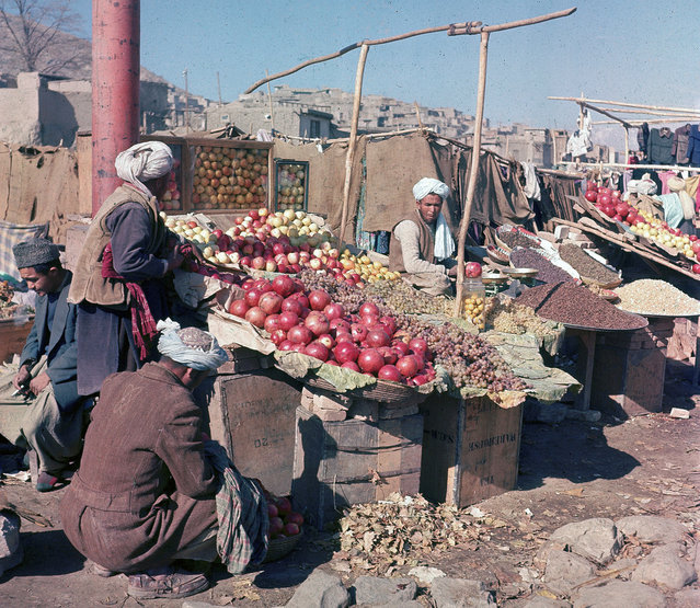 Vendors sell various fuits and nuts at an outdoor market in Kabul, in November of 1961. (Photo by Henry S. Bradsher/AP Photo via The Atlantic)