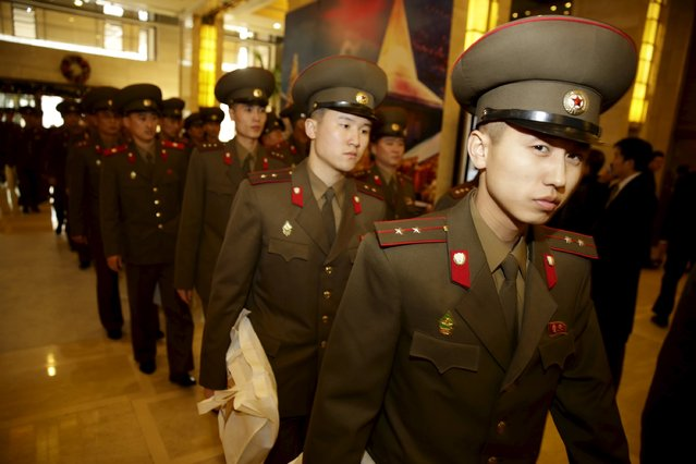 North Korean men and women in military uniforms arrive at a hotel in central Beijing, China, December 11, 2015. (Photo by Reuters/Stringer)