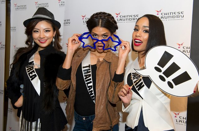 Miss Korea 2015 Kim Seo-yeon, Miss Thailand 2015 Aniporn Chalermburanawong, and Miss Japan 2015 Ariana Miyamoto pose for photos at a Chinese Laundry sponsored event at Zappos, in Las Vegas, Nevada, December 8, 2015. (Photo by Darren Decker/Reuters/The Miss Universe Organization)