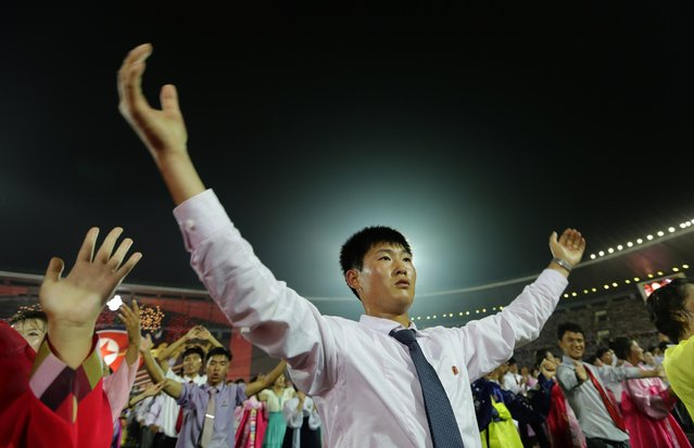 Young North Koreans gesture and cheer after a celebration to commemorate the 60th anniversary of the signing of a truce in the 1950-1953 Korean War, at Kim Il-sung Stadium in Pyongyang July 28, 2013. (Photo by Jason Lee/Reuters)